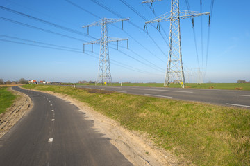 Power line in the countryside under a clear sky
