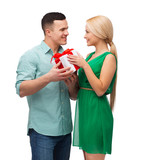smiling couple with gift box