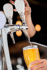 Pouring a Draft Blonde Beer from the Tap