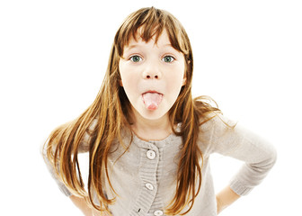 Little girl showing the tongue on white background