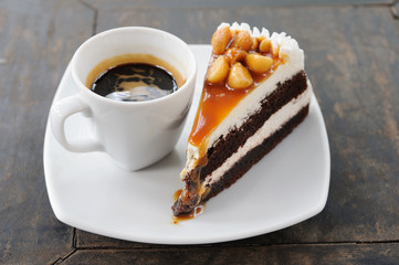Piece of cake with espresso shot, coffee.