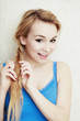 Hairstyle. Blond woman teenage girl plaiting braid hair.