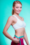 Diet. woman fit girl with measure tape measuring her waist