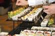 Catering stuff arranging finger food - 62429124