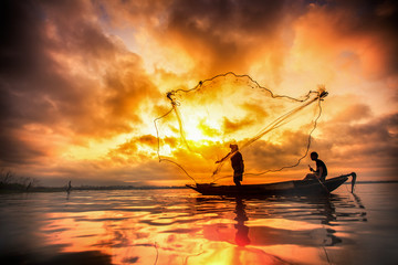 Fisherman of Bangpra Lake in action when fishing