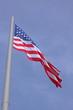 United States flag over blue sky