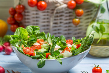 Closeup of preparing a healthy spring salad
