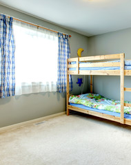 Cozy kids room with a two level bed