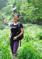 woman hiker hiking in tropical forest