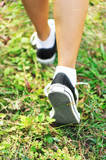 runner feet running on green grass