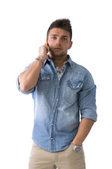 Handsome young man talking on cell phone (mobile)