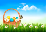 Easter background with Easter eggs in basket and butterfly on fl