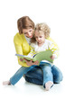 mother reading a book to kid girl