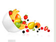 Fruit and berries falling from a bowl. Concept of healthy eating