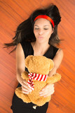 Close up portrait a woman holding teddy bear on the floor