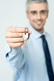 Mature realtor offering house key