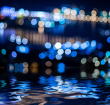 Bokeh background reflected in water surface.
