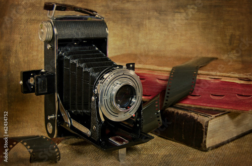 bellows camera with film and books