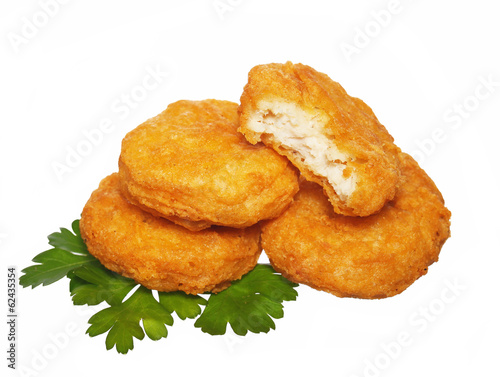 Chicken nuggets with parsley isolated on white background