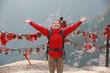 happy woman hiker open arms at huashan mountain peak