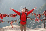 happy woman hiker open arms at huashan mountain peak