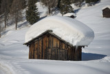 A wood cabin hut in the winter snow background
