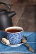 Tea set with tea crop, teapot and mug