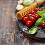 Spaghetti, basil and tomatoes