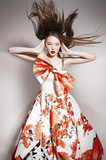 young beautiful asian brunette in gorgeous dress, motion shot, f