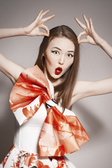 young beautiful asian brunette in gorgeous dress. building horns
