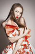 languishing look young beautiful asian brunette in gorgeous dres