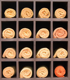 Rolled up orange spa towels