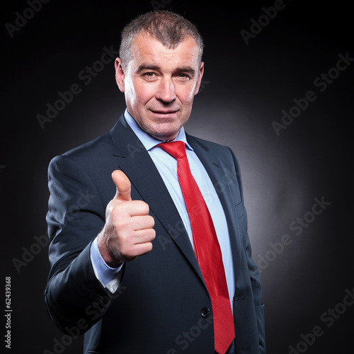 successful old business man making the ok sign