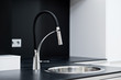 Modern stylish faucet in the black and white design kitchen - 62440322
