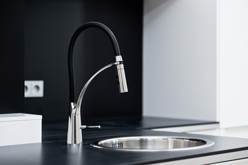 Modern stylish faucet in the black and white design kitchen