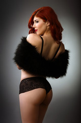 Sexy redhead woman in black lingerie