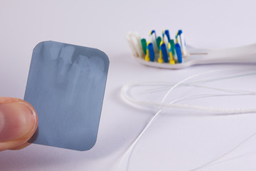 X-ray picture with a toothbrush and a dental floss