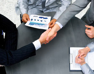 Businessmen shaking hands. Top View