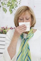 Senior Blond  woman has flu