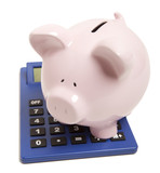 Pink piggy bank and calculator