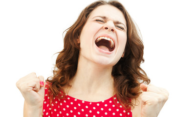 young beautiful woman in red blouse screaming with joy, isolated