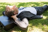 Businessman resting in park