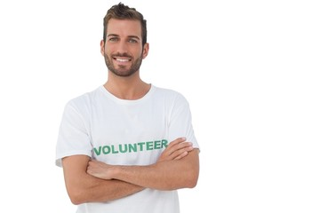 Portrait of a happy male volunteer with hands crossed