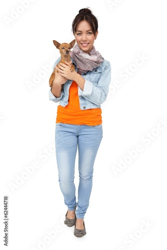 Portrait of a smiling young woman with pet dog