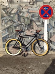 fixie in front of graffiti