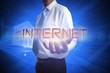 Businessman presenting the word internet