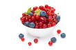 Assorted fresh seasonal berries in a bowl isolated