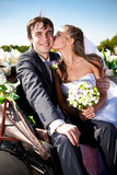 Closeup portrait of bride kissing groom at coach