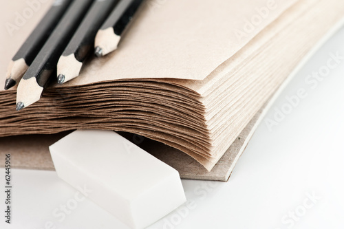 craft paper background with pencils and eraser