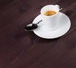 a cup of italian espresso coffee with spoon
